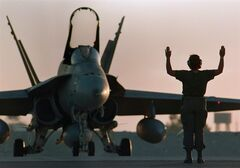 A Canadian CF-18 gets the go-ahead for takeoff at dusk at the military base in Dohar, Qatar on December 3, 1990 shortly before the start of the Gulf War.A contract to replace Canada's aging fleet of jet fighters won't be finalized until at least 2018. THE CANADIAN PRESS/Paul Chiasson