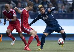 Vancouver Whitecaps FC Erik Hurtado, right, fights for control of the ball with San Jose Earthquakes Clarence Goodson, centre, as Bill Schuler, left, looks on during first half MLS soccer action in Vancouver, May, 3, 2013. Hurtado was known more for his wild hair style than his ability on the pitch prior to Saturday's match against the Columbus Crew. THE CANADIAN PRESS/Jonathan Hayward