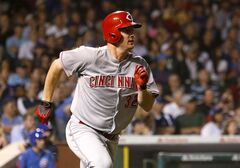 Cincinnati Reds' Jay Bruce watches his RBI double off Chicago Cubs starting pitcher Jake Arrieta during the seventh inning of a baseball game Tuesday, June 24, 2014, in Chicago. (AP Photo/Charles Rex Arbogast)