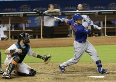 New York Mets' Travis d'Arnaud follows through on a double against the Miami Marlins in the eighth inning of a baseball game in Miami, Wednesday, Sept. 3, 2014. Matt den Dekker scored on the double. The Mets won 4-3. (AP Photo/Alan Diaz)