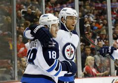 Winnipeg Jets centre Bryan Little (18) celebrates his first-period goal against the Detroit Red Wings with linemate Blake Wheeler.