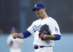 Los Angeles Dodgers starting pitcher Josh Beckett react as he comes off the field following the top of the first inning of a baseball game against the St. Louis Cardinals, Thursday, June 26, 2014, in Los Angeles. (AP Photo/Danny Moloshok)