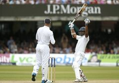 Sri Lanka's Kumar Sangakkara, right, celebrates his 100 runs not out on the third day of the first test cricket match between England and Sri Lanka at Lord's cricket ground in London, Saturday June 14, 2014. (AP Photo/Alastair Grant)