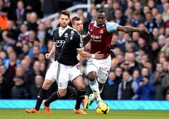 Southampton's Morgan Schneiderlin, left, and West Ham United's Guy Demel battle for the ball during the English Premier League soccer match at Upton Park, London, Saturday, Feb. 22, 2014. (AP Photo/PA, Anthony Devlin) UNITED KINGDOM OUT NO SALES NO ARCHIVE