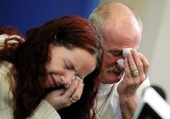 FILE - In this May 16, 2012 file photo, Mick Philpott, right, and wife Mairead react during a news conference at Derby Conference Centre following a fire at their home which claimed the lives of six of his children, Derby, England. A jury found Mick and Mairead Philpott guilty of the killing of their six children, aged 5 to 13, in a house fire in Derby, central England, in May 2012. Paul Mosley, a friend of the couple, was also convicted of manslaughter Tuesday April 2 2013. (AP Photo/PA, Rui Vieira, File) UNITED KINGDOM OUT, NO SALES, NO ARCHIVE