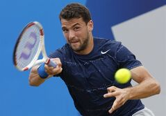 Grigor Dimitrov of Bulgaria plays a return to Stan Wawrinka of Switzerland during their Queen's Club grass court championships semifinal tennis match in London, Saturday, June 14, 2014. (AP Photo/Sang Tan)