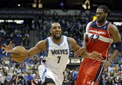 Minnesota Timberwolves' Derrick Williams, left, drives around Washington Wizards' Nene, of Brazil, in the first half of an NBA basketball game on Wednesday, March 6, 2013, in Minneapolis. (AP Photo/Jim Mone)