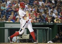 Washington Nationals Stephen Strasburg hits a double during the fourth inning of a baseball game against the Colorado Rockies at Nationals Park, on Tuesday, July 1, 2014, in Washington. (AP Photo/Evan Vucci)