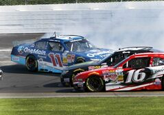Ryan Reed (16) and Kyle Busch slide under Elliott Sadler during the NASCAR Nationwide Series auto race at New Hampshire Motor Speedway Saturday, July 12, 2014, in Loudon, N.H. (AP Photo/Jim Cole)