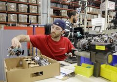 In this April 15, 2014 photo, Anthony Zingale wires blender motors at the Vitamix manufacturing facility in Strongsville, Ohio. The Labor Department releases the Producer Price Index for April on Wednesday, May 14, 2014. (AP Photo/Mark Duncan)