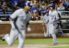 Chicago Cubs' Javier Baez, right, scores on an RBI single from Starlin Castro, left, during the third inning of a baseball game against the New York Mets, Friday, Aug. 15, 2014, in New York. (AP Photo/Frank Franklin II)