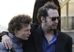 David Bar Katz, right, a friend of actor Philip Seymour Hoffman, arrives for the actor's funeral at the Church of St. Ignatius Loyola, Friday, Feb. 7, 2014 in New York. Hoffman, 46, was found dead Sunday of an apparent heroin overdose. (AP Photo/Mark Lennihan)