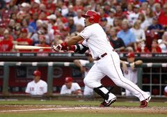 Cincinnati Reds' Brayan Pena hits a single off Cleveland Indians starting pitcher Danny Salazar in the fourth inning of a baseball game, Wednesday, Aug. 6, 2014, in Cincinnati. (AP Photo/David Kohl)