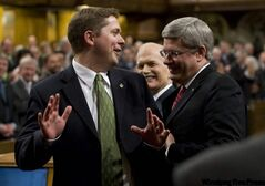 PM Stephen Harper and Jack Layton take Andrew Scheer to the Speaker's chair.