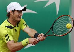 Britain's Andy Murray returns the ball to Australia's Marinko Matosevic during their second round match of the French Open tennis tournament at the Roland Garros stadium, in Paris, France, Thursday, May 29, 2014. (AP Photo/Michel Spingler)