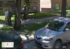 Google Street View showing a Carlton Street hydrant with a car parked next to it, ominously sporting a parking ticket on the windshield.