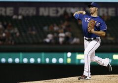 Texas Rangers relief pitcher J.P. Arencibia throws during the ninth inning of a baseball game against the Tampa Bay Rays, Wednesday, Aug. 13, 2014, in Arlington, Texas. Tampa Bay won 10-1. (AP Photo/Brandon Wade)