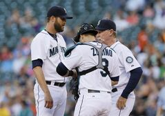 Seattle Mariners relief pitcher Tom Wilhelmsen, left, confers with catcher Mike Zunino and Mariners pitching coach Rick Waits, right, in the third inning of a baseball game against the Minnesota Twins, Thursday July 10, 2014, in Seattle. Wilhelmsen, usually a reliever, started the game and was pulled later in the third inning after giving up two runs, one of them earned. (AP Photo/Ted S. Warren)