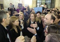 People of Freedom party leader Angelino Alfano, right, speaks at the Milan's court, in Milan, Italy, Monday, March 11, 2013. Silvio Berlusconi's judicial woes weighed on Italy's political future on Monday as prosecutors in Naples requested an accelerated trial of the former premier on corruption charges, and Milan judges in his sex-for-hire trial ordered a medical visit to certify his ailments. Angelino Alfano, the head of Berlusconi's People of Freedom Party, has said the pressure to conclude the cases is