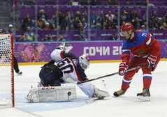 Russia forward Ilya Kovalchuk scores the winning shot in a shootout against Slovakia goaltender Jan Laco in overtime of a men's ice hockey game at the 2014 Winter Olympics, Sunday, Feb. 16, 2014, in Sochi, Russia. Russia won 1-0. (AP Photo/Mark Humphrey)
