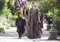 This publicity photo released by HBO shows, Peter Dinklage, left, Sibel Kekili, second left, and Sophie Turner, right, in a scene from the season finale of