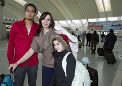 Krisztina Sebesi (centre) poses with her fiance Rex Lu and ten-year-old daughter Salena as they depart Pearson Airport in Toronto on Saturday December 8, 2012 for their Dec. 12 wedding in Aruba. As if getting engaged on New Year's Eve wasn't enough of a milestone, Krisztina Sebesi and Rex Lu are upping the ante with their choice of a once-in-a-century wedding date. They are set to exchange vows during a sunset ceremony in Aruba on Wednesday, Dec. 12, 2012 - or 12-12-12. THE CANADIAN PRESS/Frank Gunn