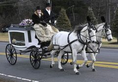 A horse-drawn carriage carries Ana Grace Marquez-Greene's casket to the First Cathedral in Bloomfield, Conn., Saturday.