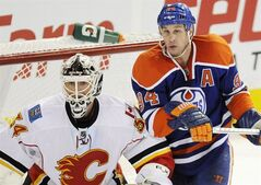 Edmonton Oilers' Ryan Smyth crowds Calgary Flames goalie Miikka Kiprusoff in NHL hockey action in Edmonton January 21, 2012. THE CANADIAN PRESS/John Ulan