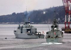 HMCS Halifax, right, and HMCS Athabaskan head out of the harbour in Halifax on Jan. 14, 2010. The shipyard that did refit work on HMCS Athabaskan says it was damaged while returning to Halifax says the repair bill had already cost $5 million more than expected before the vessel left its dock. THE CANADIAN PRESS/Andrew Vaughan