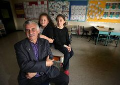 'Albert' El Tassi with granddaughters Aiche Tassi, and Hiba Souid at the Muslim school he helped create. When El Tassi arrived in Winnipeg, there were just 10 Muslim families in Winnipeg. Today, there are 15,000 Muslims in Manitoba.