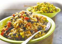 Caribbean-style rice and black bean salad (front), curried quinoa salad with yam, almonds and dried  cranberries