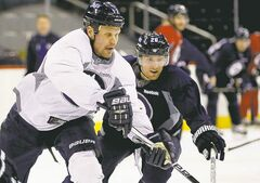 Winnipeg Jets forwards Olli Jokinen (left) and Blake Wheeler chase the puck.