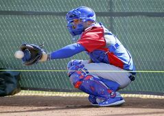Chicago Cubs catcher Welington Castillo catches during the team's first spring training baseball practice, Friday, Feb. 14, 2014, in Mesa, Ariz. (AP Photo/Matt York)