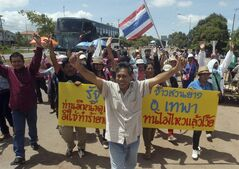 Thai rubber farmers chant slogans while making their way on a road that they have blocked during a protest in Nakhon Si Thammarat province, 580 kilometers (360 miles) south of Bangkok, Thailand, Thursday, Aug. 29, 2013. Hundreds of rubber farmers have blockaded on a major road and railway leading to Thailand's south over the past week to pressure the government to shore up declining rubber prices. Traffic has been interrupted since Friday and railway services were partly shut down this week in Cha-uat district in the province. (AP Photo/Sumeth Panpetch)