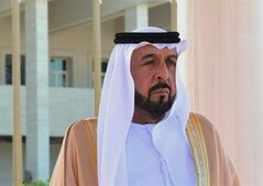 FILE - In this Monday, Jan. 30, 2012 file photo released by the Turkish Presidency Press Office, Sheik Khalifa bin Zayed Al Nahyan, president of the United Arab Emirates (UAE), listens to the national anthem during a ceremony with Turkey's President Abdullah Gul in Abu Dhabi, UAE. The state news agency of the United Arab Emirates said Saturday, Jan. 25, 2014, the country's president has suffered a stroke and undergone surgery. (AP Photo/Murat Cetinmuhurdar, Turkish Presidency Press Office, File)