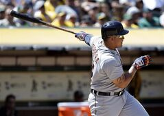Detroit Tigers' Miguel Cabrera follows through on a single against the Oakland Athletics during the seventh inning of a baseball game Thursday, May 29, 2014, in Oakland, Calif. (AP Photo/Marcio Jose Sanchez)