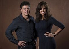 Sibling entertainers Donny, left, and Marie Osmond pose at the Princess of Wales Theatre in Toronto, Ont. on Monday, June 2, 2014. The Osmonds are bringing their wholesome brand of holiday cheer to Toronto for a two-week engagement this Christmas.THE CANADIAN PRESS/Darren Calabrese