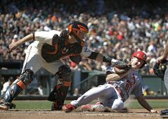 St. Louis Cardinals' Seth Maness, right, is tagged out at home plate by San Francisco Giants catcher Buster Posey, left, in the eighth inning of their baseball game Thursday, July 3, 2014, in San Francisco. Maness was trying to score from third base after the Cardinals' Jhonny Peralta lined into a double play to Giants left fielder Tyler Colvin. (AP Photo/Eric Risberg)