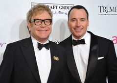 FILE - In this Oct. 18, 2010 file photo, Sir Elton John, left, and David Furnish attend the Ninth Annual Elton John AIDS Foundation benefit 'An Enduring Vision' at Cipriani Wall Street in New York. Elton John and David Furnish say they have become parents for a second time. The couple say they are