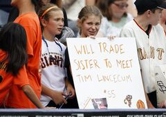 San Francisco Giants fans show their support for Giants' pitcher Tim Lincecum before a baseball game against the Kansas City Royals in Kansas City, Mo., Sunday, Aug. 10, 2014. (AP Photo/Colin E. Braley)