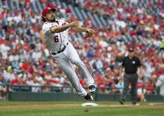 Washington Nationals third baseman Anthony Rendon throws out Arizona Diamondbacks' Cliff Pennington after Pennington attempted a bunt during the first inning of a baseball game on Thursday, Aug. 21, 2014, in Washington. (AP Photo/Evan Vucci)