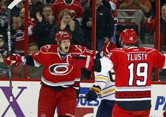 Carolina Hurricanes' Eric Staal (12) goes to congratulate Jiri Tlusty (19), of the Czech Republic, on his goal during the first period of an NHL hockey game against the Buffalo Sabres, Tuesday, March 5, 2013 in Raleigh, N.C. The Hurricanes won 4-3. (AP Photo/Karl B DeBlaker)