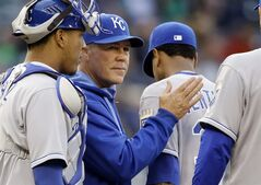ADVANCE FOR WEEKEND EDITIONS, AUG. 30-31 - FILE - In this May 10, 2014, file photo, Kansas City Royals manager Ned Yost send starting pitcher Yordano Ventura out of the game against the Seattle Mariners in a baseball game in Seattle. The recipe for small-market success goes something like this: Develop your own talent, succeed with a couple of reclamation projects, find a few diamonds in the rough and make one or two big trades to put your over the top. The Royals have followed that process exactly, and that's why the franchise is staring down its first playoff appearance in nearly 30 years. (AP Photo/Elaine Thompson, File)