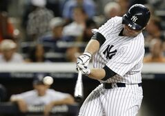 New York Yankees' Brian McCann hits a two-run home run during the fourth inning of a baseball game against the Houston Astros Tuesday, Aug. 19, 2014, in New York. (AP Photo/Frank Franklin II)