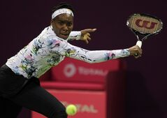 Venus Williams of the U.S. returns the ball to Petra Kvitova of the Czech Republic during the third day of the WTA Qatar Ladies Open in Doha, Qatar, Wednesday, Feb. 12, 2014. (AP Photo/Osama Faisal))
