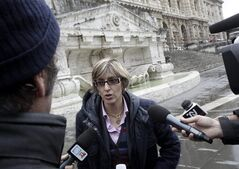 Giulia Bongiorno, lawyer of Amanda Knox's ex-boyfriend, Raffaele Sollecito, talks to reporters in front of the Italy's Court of Cassation, in Rome, Monday, March 25, 2013. Amanda Knox was waiting anxiously Monday to hear whether her ordeal is over or whether she will face trial again, as Italy's top criminal court considered whether to overturn her acquittal in the murder of her roommate. Prosecutors are asking the high court to throw out the acquittals of American Knox and her Italian ex-boyfriend in the murder of 21-year-old British student Meredith Kercher, and order a new trial. (AP Photo/Riccardo De Luca)