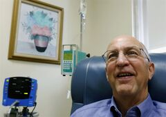 Peter Bristol of Wakefield, R.I. receives an intravenous infusion at Butler Hospital in Providence, R.I., Monday, June 9, 2014. Bristol is part of a major study that got under way Monday to see if an experimental drug could protect outwardly healthy seniors whose brains harbor silent signs that they're at risk for Alzheimer's disease. In one of the most ambitious attempts yet to thwart Alzheimer's disease, a major study got under way Monday to see if an experimental drug can protect healthy seniors whose brains harbor silent signs that they're at risk. (AP Photo/Michael Dwyer)