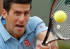Serbia's Novak Djokovic returns the ball to Croatia's Marin Cilic during their third round match of the French Open tennis tournament at the Roland Garros stadium, in Paris, France, Friday, May 30, 2014. (AP Photo/Michel Spingler)