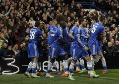 Chelsea players celebrate after Samuel Eto'o scored his 3rd goal against Manchester United's during their English Premier League soccer match at Stamford Bridge, London, Sunday, Jan. 19, 2014. (AP Photo/Sang Tan)