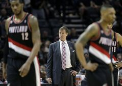 Portland Trail Blazers head coach Terry Stotts, center, stands on the sideline during the second half of Game 1 of a Western Conference semifinal NBA basketball playoff series against the San Antonio Spurs, Tuesday, May 6, 2014, in San Antonio. (AP Photo/Eric Gay)